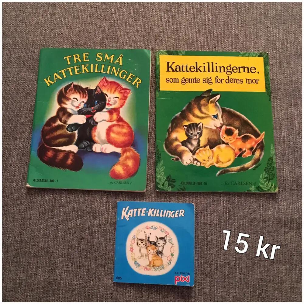 3 bøger med kattekillinger .